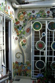 Here's another example of how to use a mosaic to extend your garden. From Owner-Builder Network: If you've missed previous mosaic ideas, simply click through this album for heaps more inspiration. lovely mosaic wall by terrand This is gorgeous :) Outdoor Mosaic Glass, Mosaic Tiles, Stained Glass, Glass Art, Gaudi Mosaic, Mosaic Wall Art, Tiling, Mosaic Crafts, Mosaic Projects