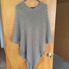 Grey Silver Knit Poncho Frayed Bottom One size fits all!!! Super awesome light weight grey poncho! Frayed bottom, crotchet style Sweaters Shrugs & Ponchos