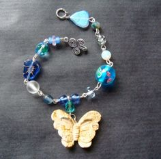 Butterfly and Flower Bracelet On Sale by thefrogbag on Etsy