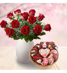 Special arrangement of long stem red roses in a clear glass vase with 1/2 Dozen Belgian Chocolate Oreo® Cookies, 1/2 Dozen Belgian Chocolate Hand Dipped Fortune Cookies, 1 Extra Large Chocolate Dipped, ourmet Brownies, 1 Custom Sugar Shortbread Cookie.