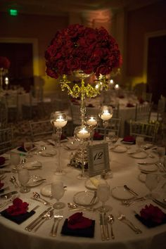 Red roses and candles make such romantic centerpieces