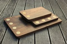 Love the inlaid brass details on these sleek walnut bread boards.
