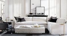 Layered artwork on console Restoration Hardware living room