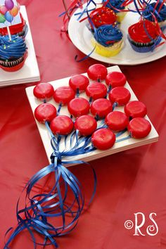 Balloon party.  So cute!   Babybel red cheese rounds made to look like a bouque of balloons