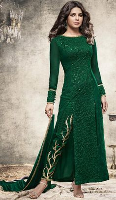 Bollywood Celebrity Priyanka Shopra Salwar Kameez in Bottle Green Color in achkan style the lovely embroidery work a substantial attribute of this attire.comes with matching dupatta and matching narrow pants.