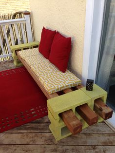 Inspired by another pinner. I used a plywood base for my cushion with foam and covered it with Outdoor fabric! dollars for each 4 by 4 and a dollar for each cinder block! Ofcourse some spray paint to just brighten up the b Outside Seating, Outdoor Seating, Outdoor Rugs, Outdoor Spaces, Outdoor Decor, Outdoor Fabric, Cinder Block Furniture, Cinder Block Bench, Cinder Blocks