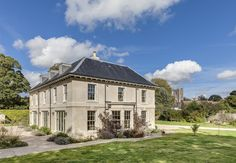 A classical home designed for the modern day life of a young family and located on a very sensitive site in the village of Avebury: a UNESCO World Heritage Site, conservation area, area of outstanding natural beauty, adjacent to listed buildings and in a Modern Georgian, Georgian Style Homes, Georgian Mansion, Listed Building, Building A House, House Cladding, Georgian Architecture, House Goals, Life Goals