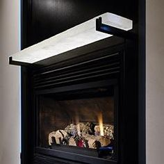 The White Glass Mantel Was Made By Glass Artist Peter David To Resemble A  Block Of. Fireplace ShelvesFireplace ...