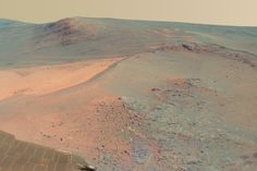 NASA has released a new panorama from its Mars Exploration Rover Opportunity, showing the terrain where the robot spent the four-month Martian winter.    The full-circle scene combines 817 images shot by the panoramic camera (Pancam).