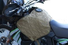 The Tank Vest is a modular, PALS webbing based storage system that allows users to attach MOLLE and ALLICE gear to their motorcycle to improve storage capacity. Tank Vests are made from 1000 denier Cordura nylon and uses a system of military grade straps and synthetic buckles to attach to the tank frame. This separates the Tank Vest from other storage options that use magnets or require drilling into the bike's frame. A feature also unique to the Tank Vest is it fits around the gas cap.