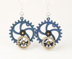 """Made in U.S.A Style # 5001D Size 1.65"""" x 1.5"""" Kinetic Gear Earring 5001D All Gears Move! Comes as shown - Royal Blue/Natural Wood/Black Satin Made from sustainably sourced materials Laser-cut wood Stained with water based dye Ear wires are silver-finished 3041 stainless steel with new electrophoretic-coating that resists tarnishing"""