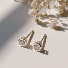 Excited to share this item from my #etsy shop: Dainty Cubic zirconia bezel stud earrings Sterling silver, dot stud earrings, Tragus stud, cartilage stud, tiny 4mm CZ silver earrings Dainty Earrings, Dainty Jewelry, Sterling Silver Earrings Studs, Bead Earrings, Silver Beads, Cartilage Stud, Jewelry Polishing Cloth, Etsy Shop, Delicate Jewelry