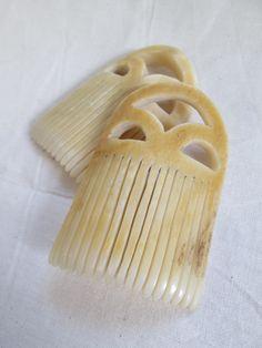 Two facsimile Bronze Age bone combs.