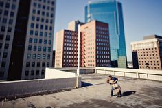Couple kissing on top of parking garage, downtown Fort Worth - Jeremy Gilliam