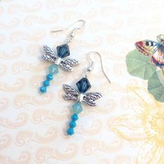 Swarovski crystal dragonfly drop earrings Various shades of Blue Swarovski crystals creating a lovely dragon fly earring on French hooks. Sayre Jewelry Earrings