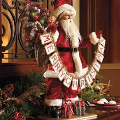 Santa Figure with Merry Christmas Sign