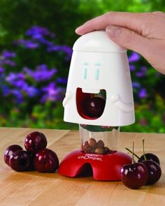 Cherry Chomper - Baking Gadgets - Events - How cool is this? Cute Kitchen, Kitchen Gifts, Kitchen Dining, Awesome Kitchen, Kitchen Products, Kitchen Decor, Quirky Kitchen, Kitchen Store, Gadgets And Gizmos