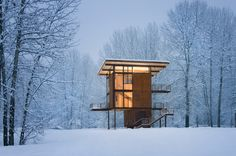 This 1,000 square-foot weekend cabin, basically a steel box on stilts, can be completely shuttered when the owner is away. Situated near a river in a floodplain, the 20' x 20' square footprint rises three stories and is topped by the living room/kitchen. Large, 10' x 18' steel shutters can be closed simultaneously using a hand crank.    Interiors by Olson Kundig Architects