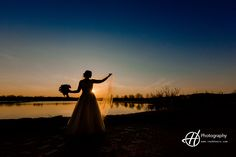 The most beautiul sunset scenery for a wedding. Amanda posing with her veil and bouquet. #HPhotography