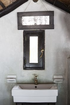 Bathroom - A sink area in a suite at Coqui Coqui, Tulum, Mexico.