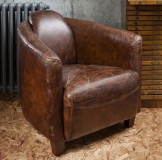 Brimming with traditional charm, this timeless armchair showcases high arms and leather upholstery. Placed with a floor lamp, it transforms a quiet corner in. Vintage Leather Sofa, Brown Leather Armchair, Leather Club Chairs, Vintage Chairs, Vintage Furniture, Leather Armchairs, Retro Armchair, Occasional Chairs, Boho