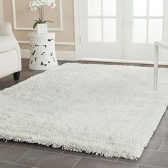 Shag Collection SG240A Classic Shag Ultra Color: White  #rug #carpet #safavieh #safaviehrug  #trendy #homedecor #homeaccents #shophome #livingroom #diningroom #bedroom #kitchen #office #rugsforyourhome #shag #shagrug #shagcarpet #softshagrugs #shagrugdesign #stunningshagrugs #safaviehshag #safaviehshagrugs #trendyrugs #bestrugs #bestrugprices