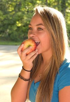 Apple | Free Stock Photo | A young woman biting an apple | # 16093