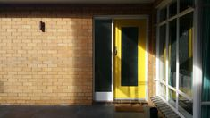 (pic 6 – One of Secret Design Studio's clients who have kept the blonde brick, triple fronted look to their home for the renovation of their classic 1960's home).