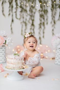 Sweet cake smash. Nice shallow depth of field. Lights aren't too distracting. Simple feminine color scheme. Not sure I'm a fan of the ivy- the dark lines of it are distracting around her head. Baby Cake Smash, 1st Birthday Cake Smash, Baby Girl 1st Birthday, Smash Cakes, Cake Smash Outfit Girl, Birthday Girl Pictures, First Birthday Photos, Birthday Ideas, Birthday Sweets