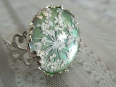 Granny Smith Apple Green-Victorian Filigree Pressed Flower Ring with Queen Anne's Lace-Sealed Beneath Glass-Symbolizes Peace. $19.00, via Etsy.