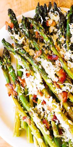 Asiago, Bacon, and Garlic Roasted Asparagus – a delicious way to cook asparagus! Asparagus comes out crispy and crunchy – you'll love the Asiago cheese and bacon combination! The recipe takes 30 minut Ways To Cook Asparagus, Oven Roasted Asparagus, Asparagus Bacon, Gluten Free Sides Dishes, Keto Side Dishes, Side Dishes For Chicken, Vegetable Side Dishes, Roast Chicken Sides, Easy Homemade Recipes