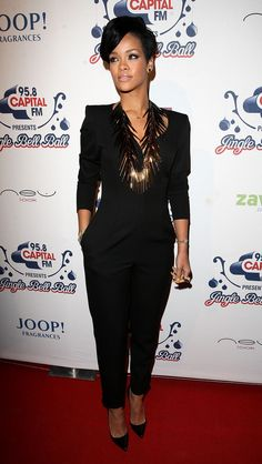 2008: Capital FM Jingle Bell Ball - Arrivals. Winged eye, that necklace, the shoulder jumpsuit and smiley face nails. Pointed patent leather Louboutins too.