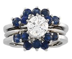 Sapphires as the ring guard make it look like a flower.. cute for a wedding band i guess