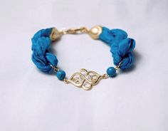 Gold filled Oriental Charm Bracelet with Turquoise Silk by Myvera, $26.00
