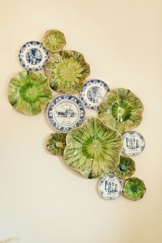 Love the green cabbage plates mixed in w/ the blue white plates! This would do well with antique majolica and Flow Blue.
