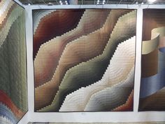 Taken at the Yokohama Quilt Show This series of quilts were by one quilt group in the same fabrics. I don't think this is bargello. It looks like curved log cabin blocks to me. Regardless, it is beautiful. Pineapple Quilt, Bargello Quilts, Log Cabin Quilts, Machine Quilting, Free Pattern, Projects To Try, Throw Pillows, Yokohama, Fabrics