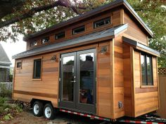 "162 sq ft with 62 sq ft loft within 22'x8.5'x13.5' exterior dimensions... i am absolutely drooling over this ""cinder box"" tiny house from shelterwisellc.com"