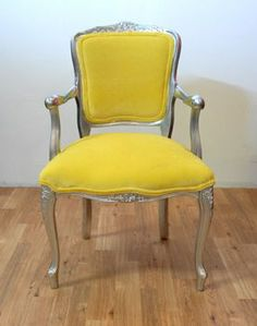 Love this bright yellow velvet Louis chair!