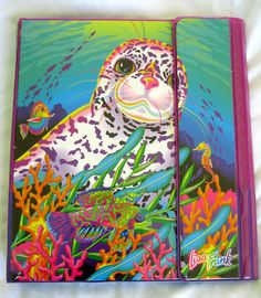 Lisa Frank + trapper keeper. Maxine, remember cleaning these out? The highlight of our day...