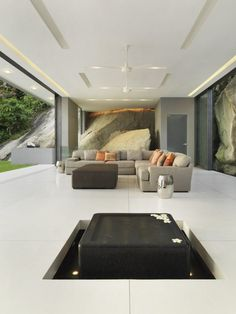 Gorgeous Villa Amanzi - Thailand.  Integration with outdoors includes feature pond and rockface