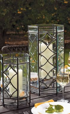 Candlelight flickers with mesmerizing, star-like quality inside our hexagonal Marquee Hurricanes. Outdoor Candles, Candle Lanterns, Outdoor Lighting, Hurricane Lanterns, Outdoor Decor, Beveled Glass, Luxury Home Decor, Glass Panels, Chandeliers