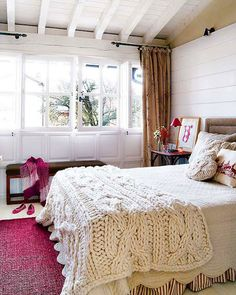 I like the textures on the bed in the cable knit bedding, the deep magenta with the neutrals, and those windows are all sorts of awesome.