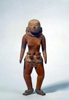Standing figure. Central America, Mexico, Veracruz, Huasteca. Classic period (AD 300-600). Buff earthenware, traces of white stucco and black paint. h. 20.2 cm. Acquired 1975. Robert and Lisa Sainsbury Collection. UEA 607. www.scva.ac.uk