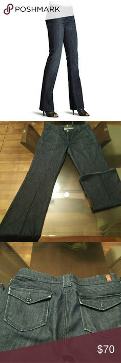 7 for all mankind Dark wash trouser jeans Comfy and stylish dark wash flap pocket trouser Jeans. Wear with heels for a night out or flats to keep it casual. Missing button on right back pocket. otherwise excellent condition. These will be your year round favorite jeans. 7 For All Mankind Jeans Flare & Wide Leg