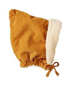It's been too long since we've seen anything quite so drop-everything-cute as this cozy cotton pincord bonnet, which brings past and present into one perfect baby moment. Cozy warm with a full lining of snuggly sherpa fleece.  - 100% cotton pincord - Lined in cozy poly sherpa fleece -Handy chin ties -