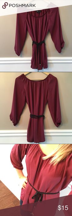 Maroon Belted Blouse I love the deep maroon color of this top!  The material is semi-sheer.  The black ribbon belt is accented with silver beads.  Simple yet chic!  EUC. AGB Tops Blouses