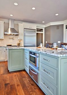 An L-shaped island. Never thought of that. Kitchen. Teal/aqua.
