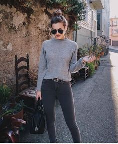 Faded black jeans and a simple grey polo-neck x