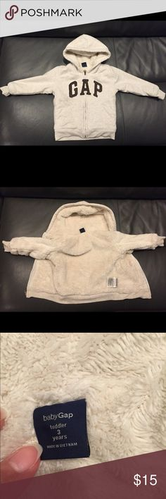Baby gap cozy fur Sherpa lined hoodie jacket - 3T Super warm and cozy faux fur lined oatmeal heather Gap hoodie for toddler boys. This is used but in great condition! We live in California so haven't had much use for it. The super soft lining covers the entire inside of the hood, body, and arms. My kids are messy so there might be some light staining to be safe, but nothing super obvious! This was only worn and washed a few times, but please refer to pics to show condition! There are no…