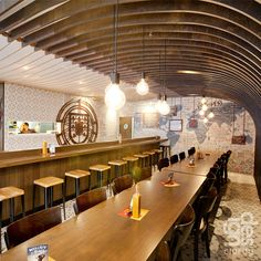 wooden arc ceiling detail at Nando's (by Design Clarity)